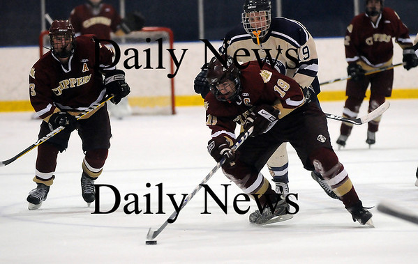 Salem: Newburyport's Kevin Holmes (19) gathers the puck during Friday night's 4-1 tournament win over top ranked Winthrop at Salem State. Photo by Ben Laing/Newburyport Daily News Friday February 27, 2009.