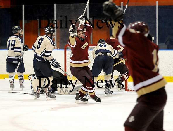 Salem: Newburyport's Derek Freeman (8) celebrates a late goal during the Clippers 4-1 win over top ranked Winthrop at Salem State. Photo by Ben Laing/Newburyport Daily News Friday February 27, 2009.