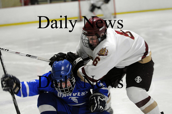 Newburyport: The Clippers Billy Eiserman (6) lays a hit on a Danvers opponent during Friday night's 6-0 Newburyport victory. Photo by Ben Laing/Newburyport Daily News Friday February 20, 2009.