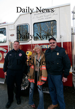 West Newbury: Jacalyn Bennett stands with police officer Jim Riley (left) and Fire Chief Rock Dower (right). Bennett donated over $30,000 to the West Newbury Fire Department. Photo by Ben Laing/Newburyport Daily News Monday February 16, 2009.