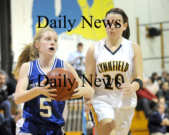 Lynnfield: Georgetown's Michelle Reilly (5) drives past Lynnfield's Abby Tobin (20) during Monday night's game in Lynnfield.  Photo by Ben Laing/Newburyport Daily News Monday February 2, 2009.