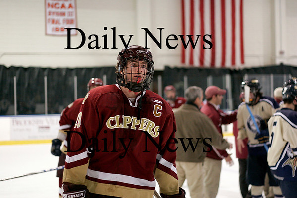 Salem: Newburyport captain Kevin Holmes (19) skates off the ice after helping his Clippers defeat top seeded Winthroop 4-1 Friday night at Salem State. Photo by Ben Laing/Newburyport Daily News Friday February 27, 2009.
