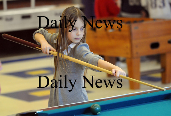 Salisbury: Christina Duni, 8, of Salisbury, plays some pool at the Boys and Girls Club in Salisbury Monday afternoon. Photo by Ben Laing/Newburyport Daily News Monday February 16, 2009.