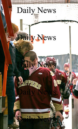 Salem: Newburyport's Derek Freeman (8) gets a hug on his way off the ice as the Clippers defeated Winthrop 4-1 at Salem Sate Friday night. Photo by Ben Laing/Newburyport Daily News Friday February 27, 2009.