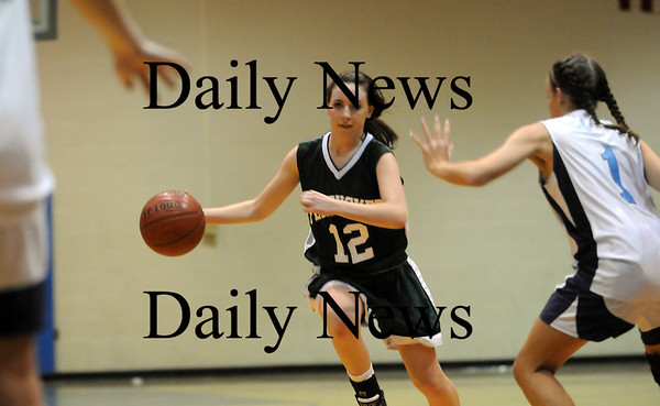 Byfield: Pentucket's Erin McNamara (12) drives to the basket while Triton's Brittany Caprio (1) trys to contain her as the two teams faced off in Byfield Thursday night. Photo by Ben Laing/Newburyport Daily News Thursday February 12, 2009.