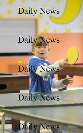 Salisbury: Lauren Fitzgerald of Salisbury takes a swing at a ping pong ball while playing after school at the Boys and Girls Club. Photo by Ben Laing/Newburyport Daily News Thursday February 12, 2009.