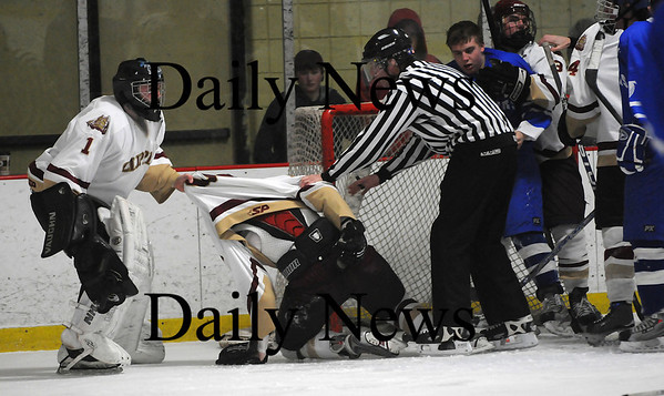 Newburyport: Clipper goalie Chris Eiserman (1) pulls his brother Billy out of a scrum mid way through the second period of Newburyport's 6-0 win over Danvers Friday night. Photo by Ben Laing/Newburyport Daily News Friday February 20, 2009.