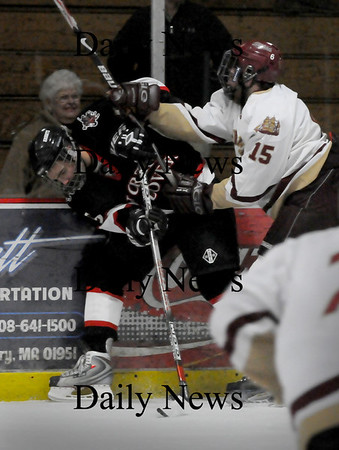 Newburyport: Newburyport's Corey Ruane checks North Andover's Robert Morandi as they go for the puck Saturday night at the Graf Rink. Photo by Bryan Eaton/Newburyport Daily News  Saturday February 14, 2008.