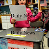 Salisbury:<br /> Brianna Tilton, 7, waves the American flag as she reads facts about the United States in Michelle Howard's class at Salisbury Elementary School on Friday during Passport Day. Second-graders researched a country and then created a presentation for that country. Brianna, a newcomer to the school this week, didn't get as much time as other students to prepare, so chose the United States which is more familiar to her and because of the historic Presidential Inauguration. <br /> Photo by Bryan Eaton/Newburyport Daily News Friday, February 06, 2009