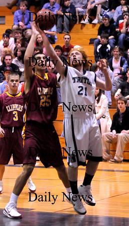 Newbury:<br /> Newburyport's Thomas Morris puts the pressure on Triton's Bert Comins last night in Byfield.<br /> Photo by Bryan Eaton/Newburyport Daily News Tuesday, February 10, 2009