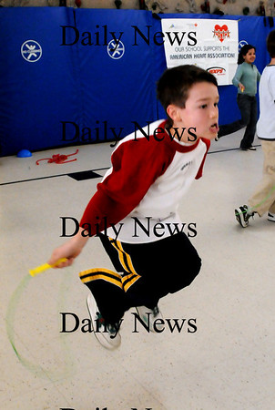 "Amesbury:<br /> Ian Ring, 9, jumps rope as fast as he can in Margaret Welch's gym class at Amesbury Elementary School on Wednesday morning. The fourth-graders were raising money for the American Heart Association's  ""Jump For Heart.""<br /> Photo by Bryan Eaton/Newburyport Daily News Wednesday, February 11, 2009"