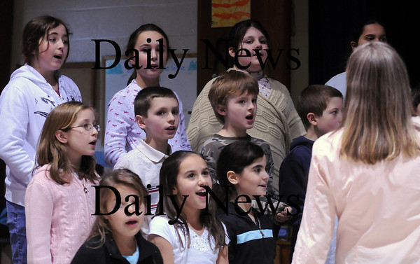 Rowley:<br /> Students at the Pine Grove School Grove School in Rowley sing the title song to Beauty and the Beast during rehearsal on Tuesday. The play will be performed later in the week.<br /> Photo by Bryan Eaton/Newburyport Daily News Tuesday, February 03, 2009