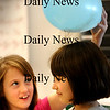 Salisbury:<br /> Bailey Capozzi's hair clings to a balloon that Kendall Mitchell, both 9, rubbed on her head causing static electricity. The fourth grade students in Kim Peterson's class were studying electricity and doing different experiments on Tuesday.<br /> Photo by Bryan Eaton/Newburyport Daily News Tuesday, February 03, 2009