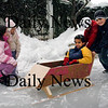 Newburyport:<br /> Tess Reid, 9, and her sister Madeleine, 5, watch as a sled is tested for this weekend's Winter Carnival. Pushing Georgie Coryell, 8, is Fergus Coryell, and Max Reid, right, both 11.<br /> Photo by Bryan Eaton/Newburyport Daily News Tuesday, February 03, 2009