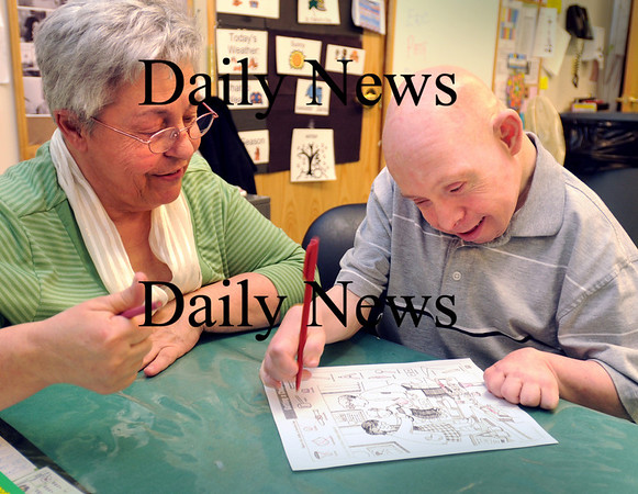 Newburyport:<br /> Tina Hawkins works with Dan Eaton of Methuen as he matches symbols on an index to those in a drawing of the inside of a home. She has been at Opportunity Works for almost 30 years, and Eaton for 16 years.<br /> Photo by Bryan Eaton/Newburyport Daily News Tuesday, February 17, 2009