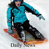 Amesbury:<br /> Sarah McAskill, 9, screams as she slides down the hill next to Amesbury Elementary School during the afterschool program on Wednesday. Despite the cold outside, the children wanted to go out, though only for 15 minutes until they went back into the cafeteria for other activities.<br /> Photo by Bryan Eaton/Newburyport Daily News Wednesday, February 04, 2009