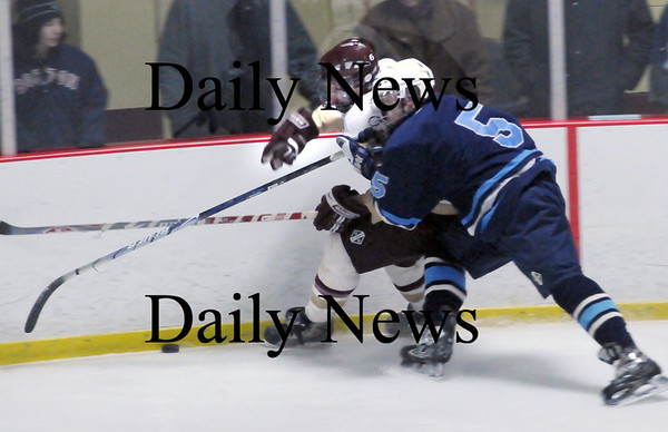 Newburyport: Wilmington's Dan Cushing crashes into Newburyport's Kevin Holmes as they go for control of the puck. Photo by Bryan Eaton/Newburyport Daily News  Wednesday February 4, 2008.