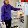 Amesbury:<br /> Laid-off Public Health Nurse of Amesbury Terry Arsenault, BSN, RN, is giving various medical supplies stored in the refrigerator and freezer to a local doctor as she cleaned out her office yesterday.<br /> Photo by Bryan Eaton/Newburyport Daily News Friday, February 27, 2009