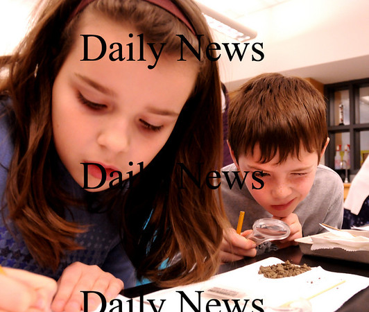 Salisbury:<br /> Matthew Duncan uses a magnifying glass to look as soil as Kendale Sicard, both 8, writes down their observations at Salisbury Elementary School. The second-graders were studying the make up and properties of the local soil--clay, sand and humus--in their science unit.<br /> Photo by Bryan Eaton/Newburyport Daily News Tuesday, February 10, 2009