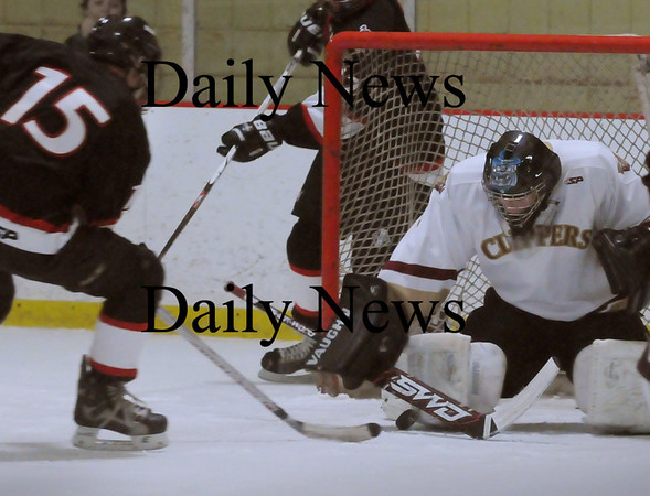 Newburyport: Newburyport goalie Christopher Eiserman stops a shot by North Andover's Brian Amor on Saturday night at the Graf Rink. Photo by Bryan Eaton/Newburyport Daily News  Saturday February 14, 2008.