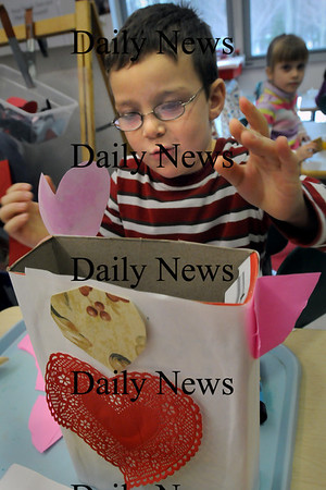 Salisbury: Travis Overbaugh, 5, makes adjustments to the Valentine's box he's making in Pauline Carrier's kindergarten class at Salisbury Elementary  School on Tuesday.  The children will exchange Valentine cards next week.