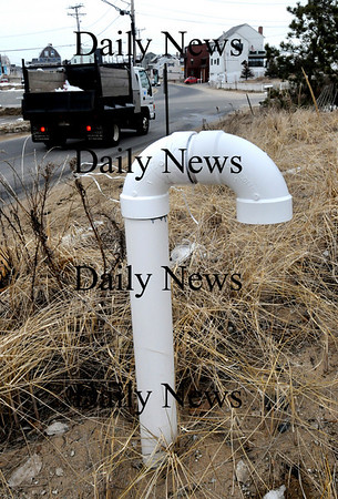 "Newbury:<br /> Residents on Plum Island are asked to listen for abnormal sounds from these sewer air intake pipes, or ""candy canes.""  Problems are being investigated with the sewer line which is having problems with the system vacuum which draws effluent through the system.<br /> Photo by Bryan Eaton/Newburyport Daily News Wednesday, February 18, 2009"