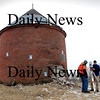 Newburyport:<br /> Michael Minton, left, and Andrew Titcomb of Meridian Associates set up a scanner to record 3-dimensional images of the Powder House behind the Newburyport National Guard Armory on Low Street. The 187 year-old structure  has fallen in disrepair and the images will help with the refurbishing.<br /> Photo by Bryan Eaton/Newburyport Daily News Thursday, February 26, 2009