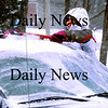 Rowley:<br /> Teacher's aid Donna Laflamme at the Pine Grove School in Rowley cleans off her truck of snow when she left school yesterday afternoon. The snow that fell last night was supposed to be lighter than forecast earlier in the weekend.<br /> Photo by Bryan Eaton/Newburyport Daily News Tuesday, February 03, 2009