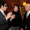 Amesbury:<br /> State Senator Stephen Baddour, left, and state Representative Michael Costello, talk with Stefanie McCowan of the Amesbury Chamber of Commerce at their Legislative Luncheon yesterday at the Powow River Grille.<br /> Photo by Bryan Eaton/Newburyport Daily News Friday, February 27, 2009