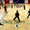 "Newburyport:<br /> Children in one of Sue Coffey's gym classes at the Bresnahan School in Newburyport play ""bull in the ring."" The game teaches defensive basketball skills and hand to eye coordination.<br /> Photo by Bryan Eaton/Newburyport Daily News Thursday, February 05, 2009"