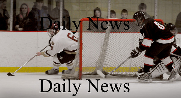 Newburyport: Newburyport's William Eiserman moves behind the North Andover net as North Andover's Matt Taylor moves to cover his goalie Saturday night at the Graf Rink. Photo by Bryan Eaton/Newburyport Daily News  Saturday February 14, 2008.