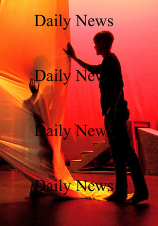 Newburyport:<br /> Kathryn Tolley, 18, as Eurydice is behind a sheet as Paul Cendron, 18, as Orpheus tries to connect as Newburyport High drama students rehearse for this weekend's Drama Festival. Photo by Bryan Eaton/Newburyport Daily News Tuesday, February 24, 2009
