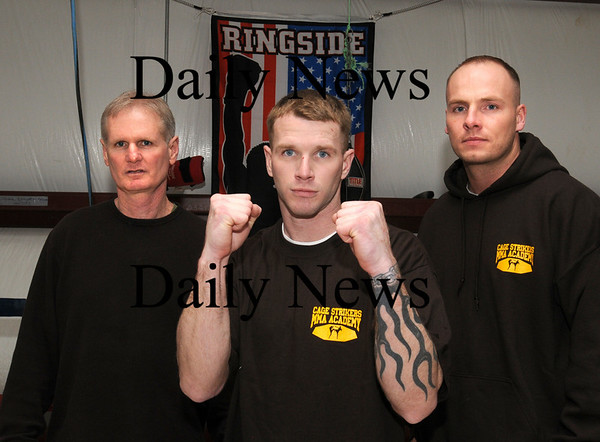Salisbury:<br /> Josh Hersey flanked by trainor/coaches Dan Greene, left, and Bill Horrocks.<br /> Photo by Bryan Eaton/Newburyport Daily News Thursday, February 19, 2009