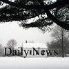 Newbury:<br /> More snow is added by last night's storm to the landmark scene of the old school house on Newbury's Lower Green.<br /> Photo by Bryan Eaton/Newburyport Daily News Tuesday, February 03, 2009