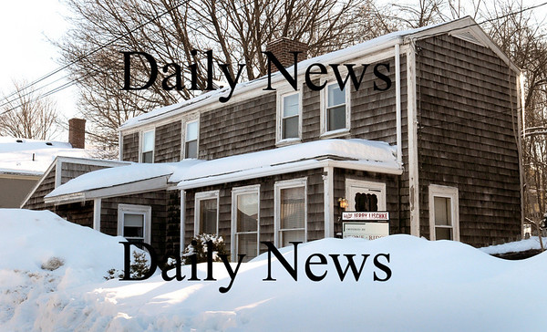 Amesbury:<br /> This single family home at 7 Kent Street in Newburyport, as seen from Merrimac Street behind the Irving gas station is for sale and listed at $199,000.<br /> Photo by Bryan Eaton/Newburyport Daily News Wednesday, February 04, 2009