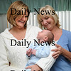 Newbury:<br /> Ann Armour, right, started an overnight baby care service that Joy Wright, with one month-old George, took advantage of.<br /> Photo by Bryan Eaton/Newburyport Daily News Wednesday, February 04, 2009