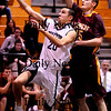 Newbury:<br /> Triton's Sam Ferrara tries for unsuccesful layup as Newburyport's Bruce Pollard covers.<br /> Photo by Bryan Eaton/Newburyport Daily News Tuesday, February 10, 2009