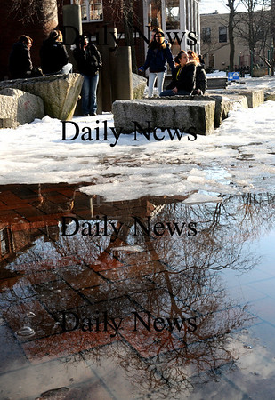 Newburyport:<br /> Teens spend time Thursday afternoon on Inn Street as melting snow creates reflections during the warming temperatures. It will be around 30 today with some wind, but warmer on Saturday with possible snow at night.<br /> Photo by Bryan Eaton/Newburyport Daily News Thursday, February 19, 2009