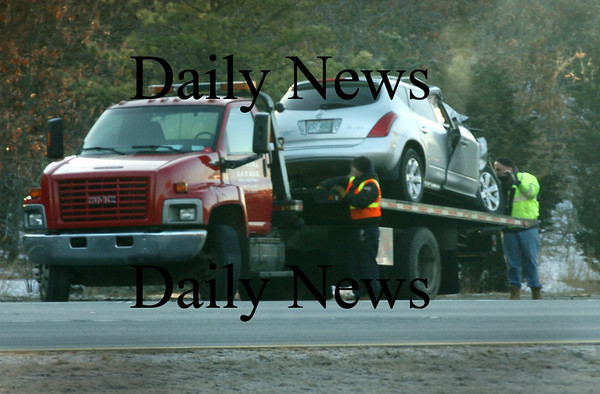 Newburyport:<br /> A vehicle involved in an accident early yesterday morning on Interstate 95 northbound, near the Newburyport Park-n-Ride, is secured to a tow truck.<br /> Photo by Bryan Eaton/Newburyport Daily News Wednesday, February 18, 2009