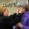 Amesbury:<br /> Laid-off Public Health Nurse of Amesbury Terry Arsenault, BSN, RN, right, gets a goodbye hug on her last day of work yesterday from Paula Klein, administrative assistant of the Council on Aging, who was also a victim of budget cuts, leaving her job last week.<br /> Photo by Bryan Eaton/Newburyport Daily News Friday, February 27, 2009