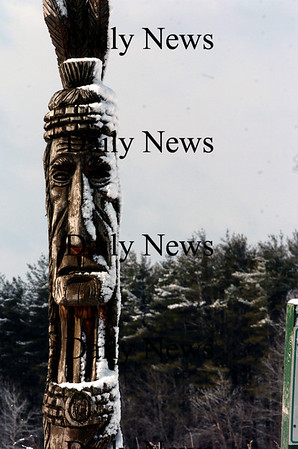 Amesbury:<br /> The totem pole at the entrance to the Battis Farm in Amesbury sports a snow-frosted face. The site of Amesbury's Community Gardens will soon be busy as spring is little over three weeks away.<br /> Photo by Bryan Eaton/Newburyport Daily News Monday, February 23, 2009