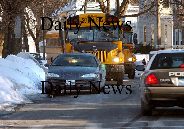 Newburyport:<br /> Many streets in the south end of Newburyport are hard to maneuver in the summer, but this winter has made things worse as snowbanks force cars further from the curbing making driving trickier. Police were called to Prospect Street yesterday afternoon as school buses heading to the Brown School couldn't get past this car.<br /> Photo by Bryan Eaton/Newburyport Daily News Friday, February 06, 2009
