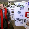Newburyport:<br /> Holocaust survivor Sonia Weitz expresses her amazement at the dozens of poster boards the seventh-graders at Nock Middle School created chronicling the Holocaust and her life set up in the school library. She later gave a presentation and spoke to students in the auditorium about her experiences.<br /> Photo by Bryan Eaton/Newburyport Daily News Wednesday, February 11, 2009