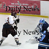 Newburyport: Wilmington goalie Zachary Rosa stops a shot by Newburyport's Kyle McElroy. Photo by Bryan Eaton/Newburyport Daily News  Wednesday February 4, 2008.
