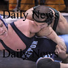 Byfield: Pentucket's Jordan Pinzone, top, tries to turn Triton's Rob West for a pin last night, just as the clock ran out in the second round. Photo by Bryan Eaton/Newburyport Daily News  Wednesday February 4, 2008.