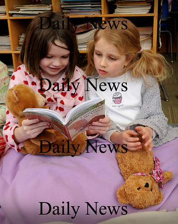 Amesbury:<br /> Annie Ronan, left, and Madlyn Creps, both 6, look through a book on Leonardo da Vinci on Tuesday morning in Billie McLane's class at Amesbury Elementary School in their pajamas with Teddy Bears. They were having a Pajama Party to mark the 100 books they've read so far this year.<br /> Photo by Bryan Eaton/Newburyport Daily News Tuesday, February 24, 2009