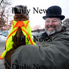 Seabrook:John Starkey holds up Seabrook Sammy at the first Ground Hog Day breakfast at the Seabrook Public Works Shed. Sammy didn't see his shadow, hopefully signifiing an early spring. photo by Jim Vaiknoras/ Newburyport Daily News. February 2, 2009