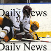 Salem: Newburyport's Collin Cusack knocked downa Bishop Fenwick'player during the Cippers 4-3 victory Tuesday night at Salem State College. photo by Jim Vaiknoras