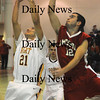 Newburyport:Amesbury's William Medvitz battles for a rebound with Newburyport's David Grabowski during their game at Newburyport Friday night. photo by Jim Vaiknoras February 13, 2009