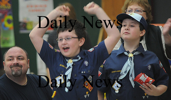 Merrimac:Ben Brindle, 9, with his twin brother Sam and his dad Jim, cheer as his car competes in the Pack 14 Pinewood Derby Saturday at the Sweetsir School. photo by Jim Vaiknoras/Newburyport Dailynews. February 7, 2009